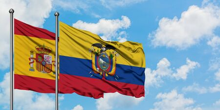Spain and Ecuador flag waving in the wind against white cloudy blue sky together. Diplomacy concept, international relations. Stock Photo