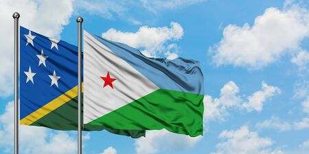 Solomon Islands and Djibouti flag waving in the wind against white cloudy blue sky together. Diplomacy concept, international relations.