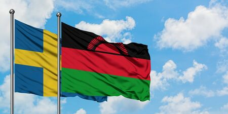 Sweden and Malawi flag waving in the wind against white cloudy blue sky together. Diplomacy concept, international relations.