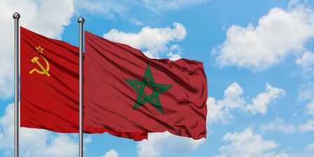 Soviet Union and Morocco flag waving in the wind against white cloudy blue sky together. Diplomacy concept, international relations.