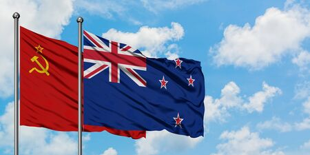 Soviet Union and New Zealand flag waving in the wind against white cloudy blue sky together. Diplomacy concept, international relations.
