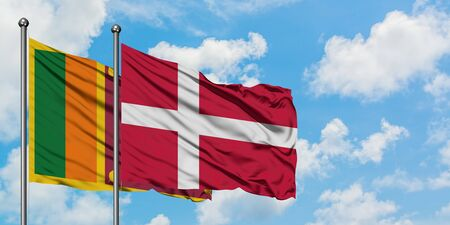 Sri Lanka and Denmark flag waving in the wind against white cloudy blue sky together. Diplomacy concept, international relations.