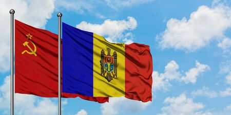 Soviet Union and Moldova flag waving in the wind against white cloudy blue sky together. Diplomacy concept, international relations.