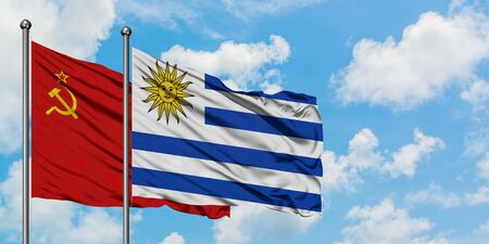 Soviet Union and Uruguay flag waving in the wind against white cloudy blue sky together. Diplomacy concept, international relations.