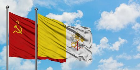 Soviet Union and Vatican City flag waving in the wind against white cloudy blue sky together. Diplomacy concept, international relations.