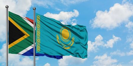South Africa and Kazakhstan flag waving in the wind against white cloudy blue sky together. Diplomacy concept, international relations.