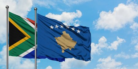 South Africa and Kosovo flag waving in the wind against white cloudy blue sky together. Diplomacy concept, international relations. 스톡 콘텐츠