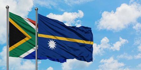 South Africa and Nauru flag waving in the wind against white cloudy blue sky together. Diplomacy concept, international relations. 스톡 콘텐츠