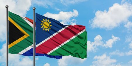 South Africa and Namibia flag waving in the wind against white cloudy blue sky together. Diplomacy concept, international relations. 스톡 콘텐츠