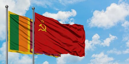 Sri Lanka and Soviet Union flag waving in the wind against white cloudy blue sky together. Diplomacy concept, international relations.