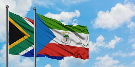South Africa and Equatorial Guinea flag waving in the wind against white cloudy blue sky together. Diplomacy concept, international relations.