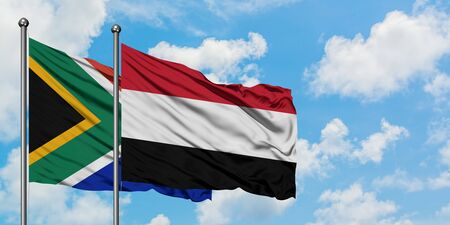 South Africa and Yemen flag waving in the wind against white cloudy blue sky together. Diplomacy concept, international relations.