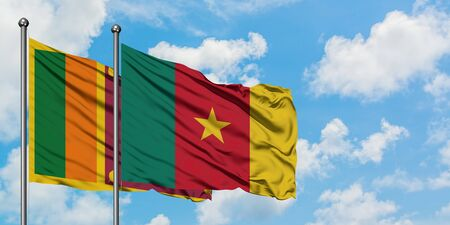 Sri Lanka and Cameroon flag waving in the wind against white cloudy blue sky together. Diplomacy concept, international relations.