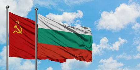 Soviet Union and Bulgaria flag waving in the wind against white cloudy blue sky together. Diplomacy concept, international relations.