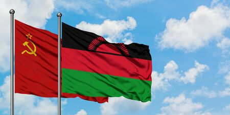 Soviet Union and Malawi flag waving in the wind against white cloudy blue sky together. Diplomacy concept, international relations.