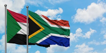 Sudan and South Africa flag waving in the wind against white cloudy blue sky together. Diplomacy concept, international relations.