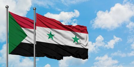 Sudan and Syria flag waving in the wind against white cloudy blue sky together. Diplomacy concept, international relations.