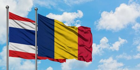 Thailand and Chad flag waving in the wind against white cloudy blue sky together. Diplomacy concept, international relations.