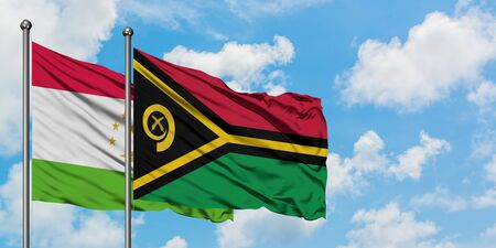 Tajikistan and Vanuatu flag waving in the wind against white cloudy blue sky together. Diplomacy concept, international relations. Stock fotó