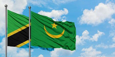 Tanzania and Mauritania flag waving in the wind against white cloudy blue sky together. Diplomacy concept, international relations.
