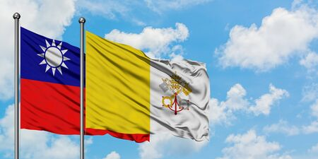 Taiwan and Vatican City flag waving in the wind against white cloudy blue sky together. Diplomacy concept, international relations. 版權商用圖片