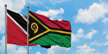 Trinidad And Tobago and Vanuatu flag waving in the wind against white cloudy blue sky together. Diplomacy concept, international relations. Stock fotó