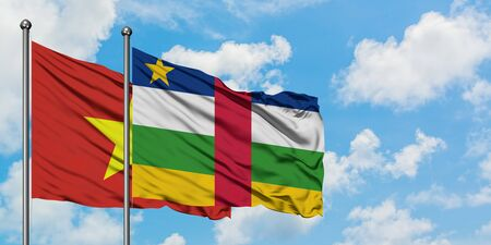 Vietnam and Central African Republic flag waving in the wind against white cloudy blue sky together. Diplomacy concept, international relations.