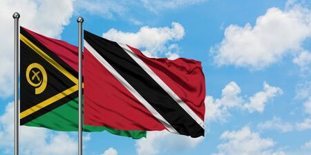 Vanuatu and Trinidad And Tobago flag waving in the wind against white cloudy blue sky together. Diplomacy concept, international relations. Stock fotó