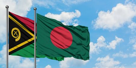 Vanuatu and Bangladesh flag waving in the wind against white cloudy blue sky together. Diplomacy concept, international relations.