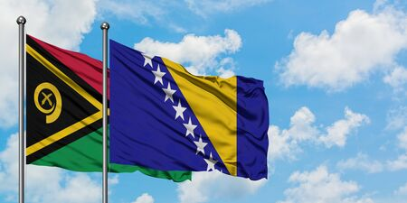 Vanuatu and Bosnia Herzegovina flag waving in the wind against white cloudy blue sky together. Diplomacy concept, international relations. Stock fotó