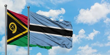 Vanuatu and Botswana flag waving in the wind against white cloudy blue sky together. Diplomacy concept, international relations.