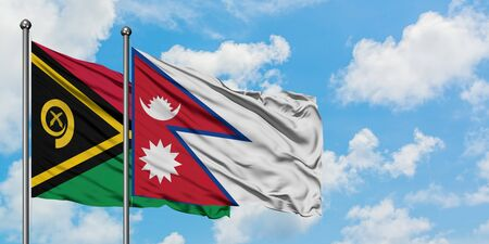 Vanuatu and Nepal flag waving in the wind against white cloudy blue sky together. Diplomacy concept, international relations.