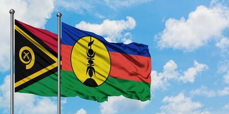 Vanuatu and New Caledonia flag waving in the wind against white cloudy blue sky together. Diplomacy concept, international relations.
