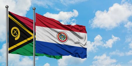Vanuatu and Paraguay flag waving in the wind against white cloudy blue sky together. Diplomacy concept, international relations. Stock fotó