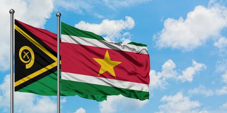 Vanuatu and Suriname flag waving in the wind against white cloudy blue sky together. Diplomacy concept, international relations.