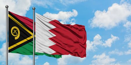 Vanuatu and Bahrain flag waving in the wind against white cloudy blue sky together. Diplomacy concept, international relations. Stock fotó
