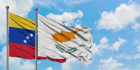 Venezuela and Cyprus flag waving in the wind against white cloudy blue sky together. Diplomacy concept, international relations.