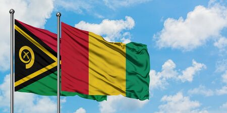 Vanuatu and Guinea flag waving in the wind against white cloudy blue sky together. Diplomacy concept, international relations.