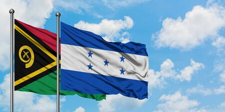 Vanuatu and Honduras flag waving in the wind against white cloudy blue sky together. Diplomacy concept, international relations.