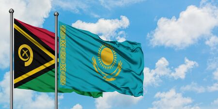 Vanuatu and Kazakhstan flag waving in the wind against white cloudy blue sky together. Diplomacy concept, international relations.