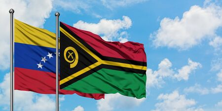 Venezuela and Vanuatu flag waving in the wind against white cloudy blue sky together. Diplomacy concept, international relations.