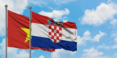 Vietnam and Croatia flag waving in the wind against white cloudy blue sky together. Diplomacy concept, international relations.