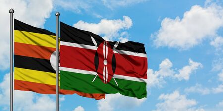 Uganda and Kenya flag waving in the wind against white cloudy blue sky together. Diplomacy concept, international relations.
