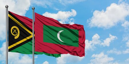 Vanuatu and Maldives flag waving in the wind against white cloudy blue sky together. Diplomacy concept, international relations.