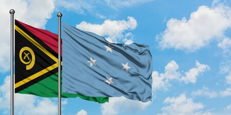 Vanuatu and Micronesia flag waving in the wind against white cloudy blue sky together. Diplomacy concept, international relations.