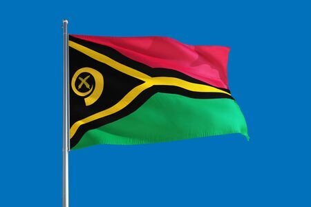 Vanuatu national flag waving in the wind on a deep blue sky. High quality fabric. International relations concept. Stock fotó