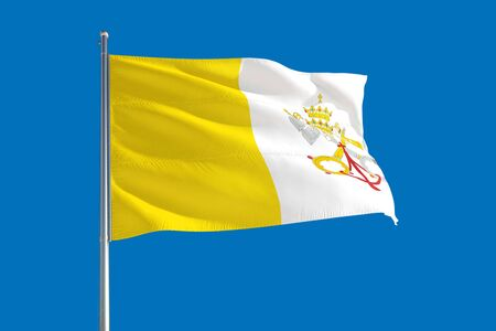 Vatican City national flag waving in the wind on a deep blue sky. High quality fabric. International relations concept.