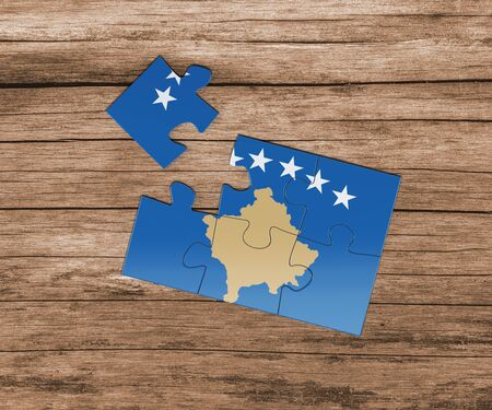Kosovo national flag on jigsaw puzzle. One piece is missing. Danger concept.