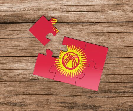 Kyrgyzstan national flag on jigsaw puzzle. One piece is missing. Danger concept. Banque d'images