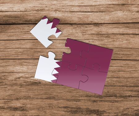 Qatar national flag on jigsaw puzzle. One piece is missing. Danger concept. 版權商用圖片